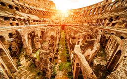 Ruins of the Colosseum arena in Rome, Italy. Inside the Colosseum or Coliseum in summer, Rome, Italy. Colosseum is the main travel attraction of Roma. Ruins of Royalty Free Stock Images