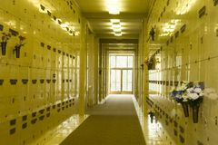 Inside the Columbarium. A look down the hallway in a columbarium where urns containing ashes are kept Royalty Free Stock Image