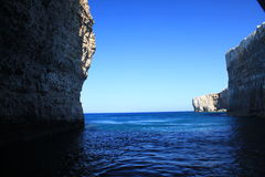 Inside Comino cave. View from the cave on the Comino island. Malta Royalty Free Stock Image