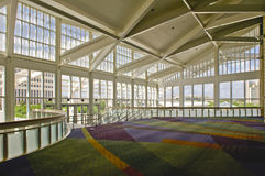 Inside of Convention Center. The inside of the Orange County Convention Center in Orlando, Florida. An entrance hallway with a view out of the many windows Royalty Free Stock Image