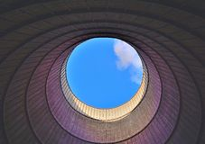 Inside a cooling tower. View of the huge chimney of an abandoned cooling tower Stock Photos