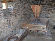 Inside of corn mill in Ghyaru village, Nepal. Annapurna circuit, Marsyangdi river valley, Nepal Royalty Free Stock Photos