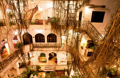Inside the courtyard of old hotel with overgrown vines branches Royalty Free Stock Photos