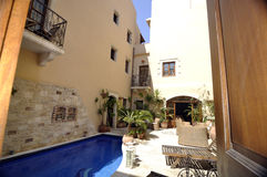 Inside of the Cretan courtyard. Inside of the Cretan house where everything is made for rest and relaxation Stock Photo