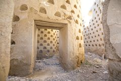 Inside crumbling walls of dovecote mud building in Ampudia