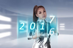 Inside cyber world. 2017 new year concept. Pretty asian woman wearing latex jumpsuit. Inside cyber world. 2017 new year concept Royalty Free Stock Photo