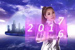 Inside cyber world. 2017 new year concept. Pretty asian woman wearing latex jumpsuit. Inside cyber world. 2017 new year concept Stock Photography