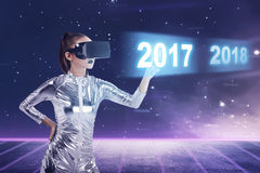 Inside cyber world. 2017 new year concept. Pretty asian woman wearing latex jumpsuit. Inside cyber world. 2017 new year concept Royalty Free Stock Photography