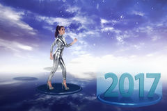 Inside cyber world. 2017 new year concept. Pretty asian woman wearing latex jumpsuit. Inside cyber world. 2017 new year concept Royalty Free Stock Image