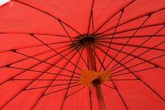 Inside czerwony parasol Fotografia Stock