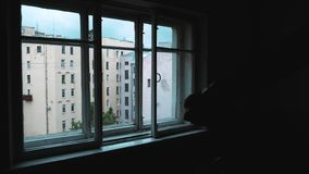 Inside dark room window view on city multistory houses building stock video footage
