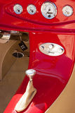 Inside dash of a red hot rod royalty free stock photos