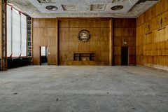 Mid-Century Styled Wood Paneled Courtroom - Abandoned Courthouse. Inside a derelict wood paneled courtroom with Mid-Century styling inside an abandoned Stock Photos