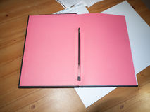 Inside desktop notepad with ball point pen for taking notes for. Studying and students; Essex; UK stock image