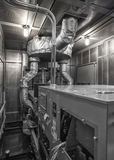 Inside of diesel generator weatherproof enclosure. Monochrome image. Sound attenuated reducing decibel level stock images