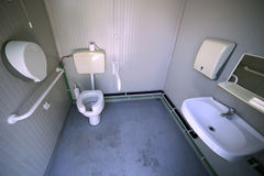 Inside the disabled bathroom with the special water closet. And support bar Royalty Free Stock Photo