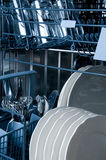 Inside a Dishwasher. With blue toned Royalty Free Stock Photo