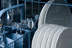 Inside a Dishwasher. With blue toned Stock Photography