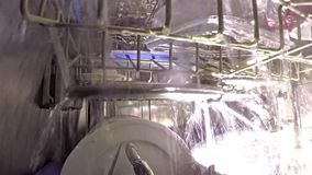 Inside the dishwasher. Dishwasher washes - an inside view stock footage