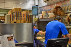 Inside Dominos Pizza fast food Stock Photography