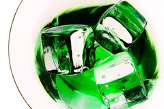 Inside a drink. ( green drink with ice cubes Stock Image