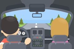 Inside driving car. Man and woman sitting in the car. Rural landscape Stock Image