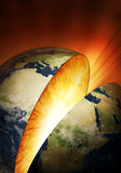 Inside earth explosion. Planet Earth breaking in two (Elements of this image furnished by NASA: earthmap  http://visibleearth.nasa.gov Royalty Free Stock Image