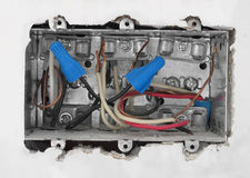 Inside of an electrical box in drywall. Royalty Free Stock Photos