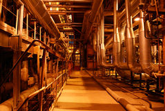 Inside of electrical power plant. Cabeles and pipes on power plant Stock Photos