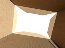 Inside an empty cardboard box with white background Stock Photo