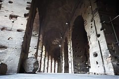 Inside empty gallery with arches within Colosseum Royalty Free Stock Image