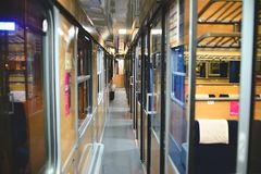 Inside an empty passenger car high-speed train. In the evening Stock Photography
