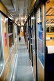 Inside an empty passenger car high-speed train. In the evening Royalty Free Stock Photo