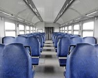 Inside the empty train. Inside the empty modern ukrainian suburban train. Rows of blue seats Royalty Free Stock Image