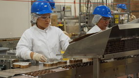 Inside Ethel M chocolate factory. Factory employees producing chocolate in Ethel M chocolate factory Stock Image