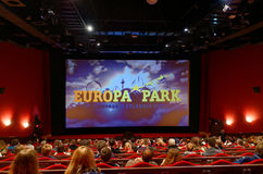Inside Europa Park cinema. The auditorium of the cinema in Europa Park Rust, Germany, with people waiting for the movie to start Royalty Free Stock Image
