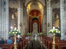 Inside the Expiatory Temple to Christ The King in Villa Gustavo Madero, Mexico City. Patrons visiting the Expiatory Temple to Christ The King in Mexico City Royalty Free Stock Photos