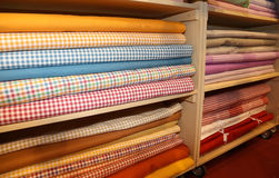 Inside the fabric store with many textile products for sale Stock Photos
