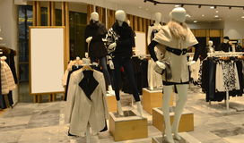 inside of a fashion clothing shop,Autumn winter fashion Mannequins  Royalty Free Stock Photography