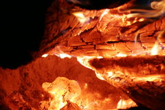 Inside the fire. Close-up of woods burning in fireplace Royalty Free Stock Image