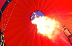 Inside flame of a hot air balloon. The flame inside a red hot air balloon Royalty Free Stock Photo