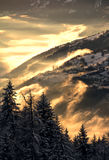 Inside the fog. The mountains in the fog in the rays of setting sun in French Alps Stock Image
