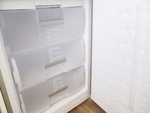Inside freezer. Inside white freezer open door Stock Image