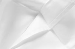 Inside fresh white damask cloth napkin Royalty Free Stock Photo