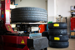 Inside a garage - changing wheels/tires Royalty Free Stock Photos