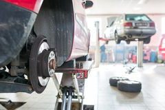Inside a garage - changing wheels/tires Stock Images