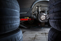 Inside a garage - modern car waiting for the mechanic Royalty Free Stock Photography