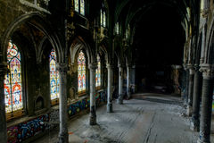 Dark Sanctuary with Stunning Stained Glass Windows and Wood Floor - Abandoned Church stock images