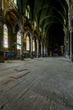 Dark Sanctuary with Stunning Stained Glass Windows and Wood Floor - Abandoned Church stock photos
