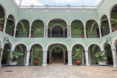 Inside Governor Palace in Merida, Mexico. Inside beautiful patio plaza of government palace in Merida, Mexico featuring colonial-style architecture with green Stock Photos